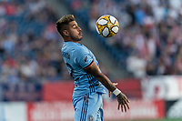 FOXBOROUGH, MA - SEPTEMBER 29: Ronald Matarrita #22 of New York City FC chest trap during a game between New York City FC and New England Revolution at Gillette Stadium on September 29, 2019 in Foxborough, Massachusetts.