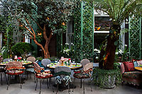 The garden terrace at Annabel's Club in London, designed by Martin Brudnizki with bespoke fabrics by House of Hackney.