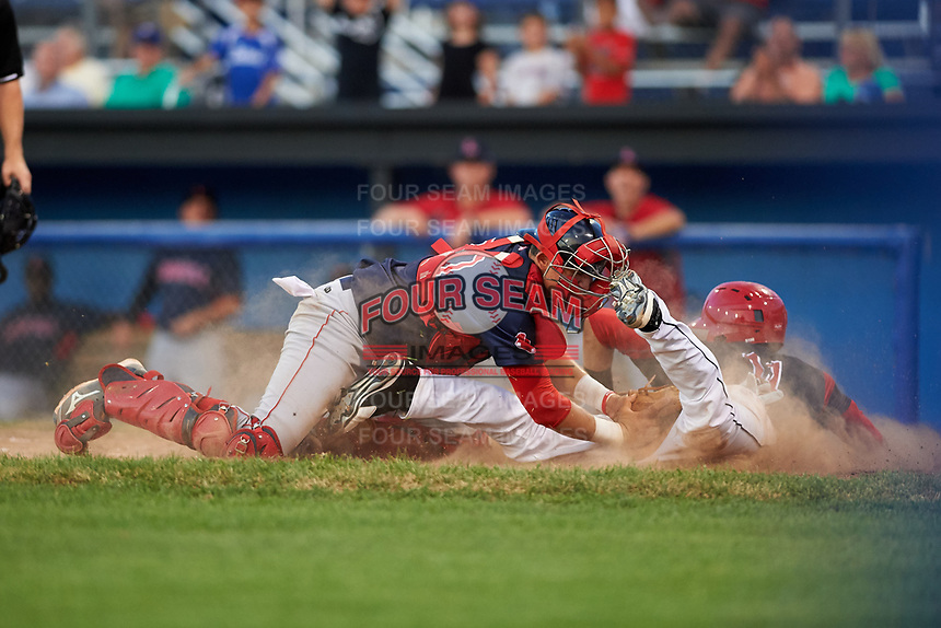 Lowell Spinners catcher Samuel Miranda (20) tags out Tyler Curtis (11) attempting to score a run in the bottom of the sixth inning during a game against the Batavia Muckdogs on July 11, 2017 at Dwyer Stadium in Batavia, New York.  Lowell defeated Batavia 5-2.  (Mike Janes/Four Seam Images)