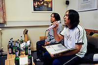 GERMANY Hamburg, Filipino seaman in seaman´s club Duckdalben, drinking beer and singing Karaoke / DEUTSCHLAND Hamburg , Seemannsclub Duckdalben eine soziale Einrichtung der Diakonie fuer Betreuung von Seeleuten, philippinische Seeleute singen Karaoke mit ein paar Becks Bier
