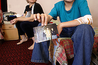 12 and ½ years Chechen boy with a picture of is family left in Chechnya..His life as a man have no future in Chechnya. With is mother, they decide to survive abroad and arrive 2 month a go at the URiC Wola refugee centre, in Poland..He speck already fluently Polish and a little of English..His grandmother and is grandfather died under the Russian bombardment..-For security reason, the face of the adult asylum seeker have been evicted of the photography..-For security reason, the names of the adult asylum seeker have been change. .-Article 9 of the Act of 13 June 2003 on grating protection on the Polish territory (Journal of Laws, No 128, it. 1176) personal data of refugees are an object of particular protection..-Cases where publication of a picture or name of asylum seeker had dramatic consequences for this persons and is family back in Chechnya. .Please have safety of those people in mind. Thank you.