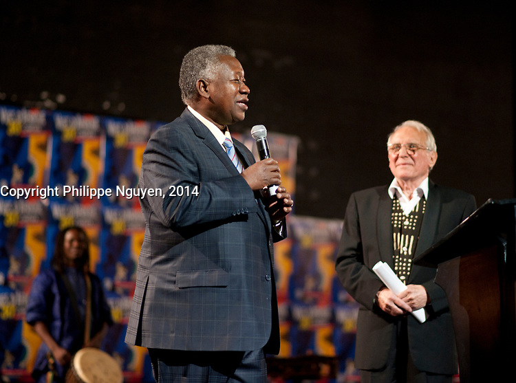 Guila Thiam (L) and Gerald De Chene, President, Vues D'afriques (cinema festival) (R) speak at the Festival  30the anniversary at the Imperial Cinema in Montreal, Canada, April 25, 2014.<br /> <br /> Photo : Philippe Nguyen
