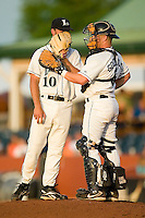 Lexington starting pitcher Casey Hudspeth (10) and catcher James Goethals (5) have a conversation on the mound versus West Virginia at Applebee's Park in Lexington, KY, Thursday, June 7, 2007.