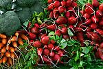 Fresh picked radishes, carrots, and broccoli. Farmer's market at San Luis Obispo, California