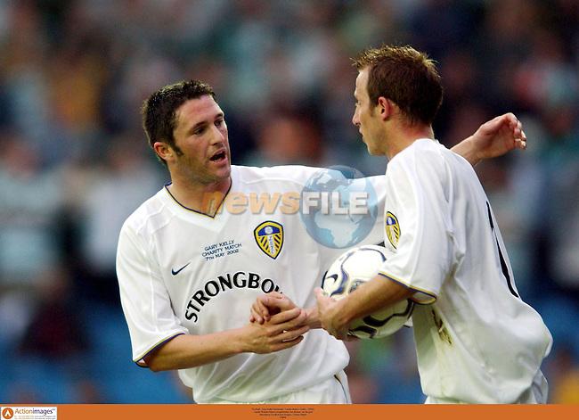 Football - Gary Kelly Testmonial - Leeds United v Celtic - 7/5/02.Leeds' Robbie Keane congratulates Lee Bowyer on his goal.Mandatory Credit:Action Images / Darren Walsh.Digital