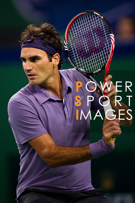 SHANGHAI, CHINA - OCTOBER 14:  Roger Federer of Switzerland returns a ball to Andreas Seppi of Italy during day four of the 2010 Shanghai Rolex Masters at the Shanghai Qi Zhong Tennis Center on October 14, 2010 in Shanghai, China.  (Photo by Victor Fraile/The Power of Sport Images) *** Local Caption *** Roger Federer