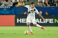 CARSON, CA - SEPTEMBER 15: Diego Polenta #3 of the Los Angeles Galaxy crosses a ball during a game between Sporting Kansas City and Los Angeles Galaxy at Dignity Health Sports Complex on September 15, 2019 in Carson, California.