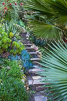 Stepping stones in gravel path down steep hillside,Jim Bishop and Scott Borden garden