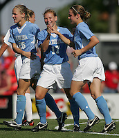 OCT 2, 2005: College Park, MD, USA:  UNC Tarheel midfielder #17 Lori Chalupny and #20 Heather O'Reilly celebrates a goal by teammate #25 Lindsey Tarpley while playing the  Maryland Terrapins at Ludwig Field.  UNC won, 4-0. Mandatory Credit: Photo By Brad Smith (c) Copyright 2005 Brad Smith