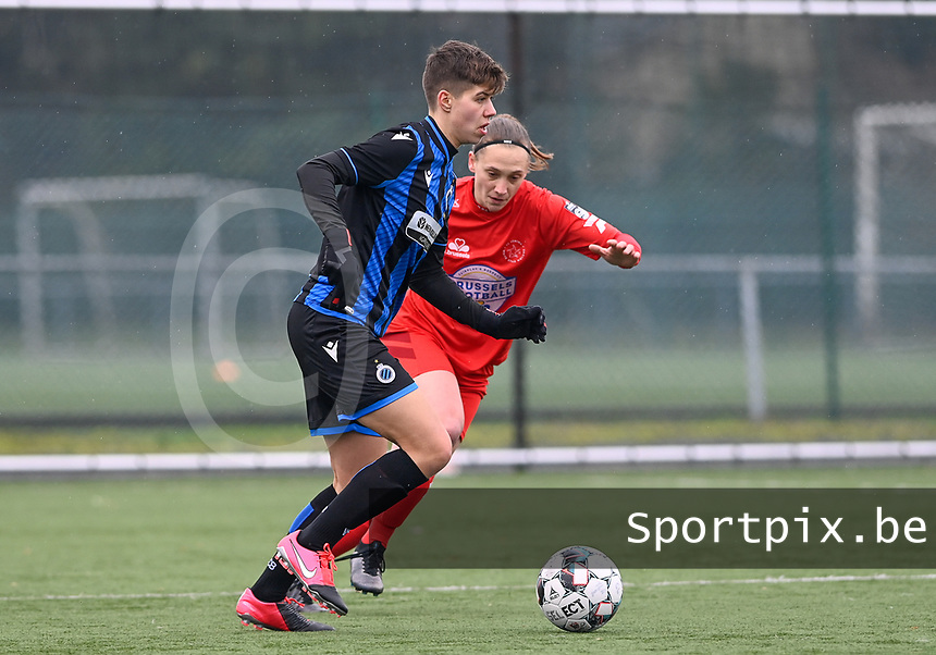 Isabelle Iliano (18) of Club Brugge pictured with Clotilde Codden (23) of Woluwe during a female soccer game between Club Brugge Dames YLA and White Star Woluwe on the 12 th matchday of the 2020 - 2021 season of Belgian Scooore Womens Super League , saturday 30 January 2021  in Brugge , Belgium . PHOTO SPORTPIX.BE | SPP | DAVID CATRY