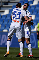 Robin Gosens of Atalanta BC celebrates with Hans Hateboer after scoring the goal of 0-1 during the Serie A football match between US Sassuolo and Atalanta BC at Citta del Tricolore stadium in Reggio Emilia (Italy), May 2nd 2021. Photo Andrea Staccioli / Insidefoto
