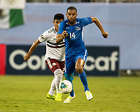 CHARLOTTE, NC - JUNE 23: Yann Thimon #14 defends during a game between Mexico and Martinique at Bank of America Stadium on June 23, 2019 in Charlotte, North Carolina.