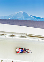 5 December 2014: Inars Kivlenieks, sliding for Latvia, slides through Curve Number 14 on his first run, ending the day with a 20th place finish and a combined 2-run time of 1:44.364 in the Men's Competition at the Viessmann Luge World Cup, at the Olympic Sports Track in Lake Placid, New York, USA. Mandatory Credit: Ed Wolfstein Photo *** RAW (NEF) Image File Available ***