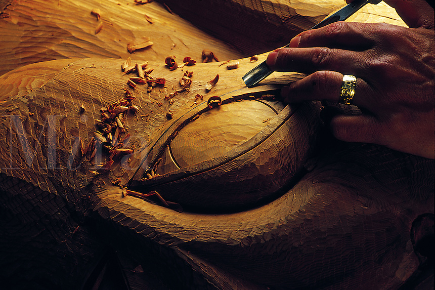 Detail of a traditional Native Alaskan totem being carved.