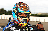 Nov. 13, 2011; Pomona, CA, USA; NHRA top fuel dragster driver Antron Brown during the Auto Club Finals at Auto Club Raceway at Pomona. Mandatory Credit: Mark J. Rebilas-.