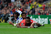 Mathieu Bastareaud of RC Toulon scores a try in the dying seconds of the first half