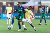 HARTFORD, CT - AUGUST 17: Derek Dodson #14 of Hartford Athletic and Romario Piggott #8 of Charleston Battery battle for the ball during a game between Charleston Battery and Hartford Athletic at Dillon Stadium on August 17, 2021 in Hartford, Connecticut.