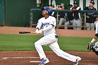 Stefen Henderson (12) of the Ogden Raptors in action against the Grand Junction Rockies during Opening Night of the Pioneer League Season on June 16, 2014 at Lindquist Field in Ogden, Utah. (Stephen Smith/Four Seam Images)