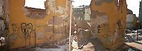 Snapcase graffiti on destroyed building<br />