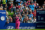 Xiyu Lin of China plays a shot as a gallery of fans watch during the Hyundai China Ladies Open 2014 at World Cup Course in Mission Hills Shenzhen on December 14 2014, in Shenzhen, China. Photo by Xaume Olleros / Power Sport Images