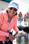 Tammy Callahan shows off her catch during the Casting for Recovery fishing clinic at Bently Ranch in Gardnerville, Nev. May 4, 2018.<br /> Photo by Candice Vivien/Nevada Momentum