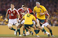 MELBOURNE, 29 JUNE 2013 - Dan LYDIATE of the Lions is tackled by Christian LEALI'IFANO of the Wallabies during the Second Test match between the Australian Wallabies and the British & Irish Lions at Etihad Stadium on 29 June 2013 in Melbourne, Australia. (Photo Sydney Low / sydlow.com)