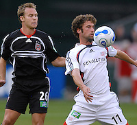 New England Revolution Pat Noonan chesting the ball while covered by DC United defender Bryan Namoff. DC United defeated the New England Revolution 1-0 at RFK Stadium, Washington DC, June 3, 2006.
