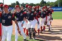 Batavia Muckdogs players, including Geral Silva (37), Hunter Wells (40), Pablo Garcia (7), Isaiah White (18), and Corey Bird (12), congratulate each other after a game against the Auburn Doubledays on September 5, 2016 at Dwyer Stadium in Batavia, New York.  Batavia defeated Auburn 4-3. (Mike Janes/Four Seam Images)
