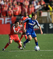 26 April 2009: Kansas City Wizards defender Matt Besler #5 takes the ball as Toronto FC forward Pablo Vitti #8 gives chase in MLS action at BMO Field in Toronto in a  game between Kansas City Wizards and Toronto FC..Toronto FC won 1-0.