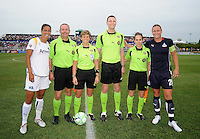 Team captains Shannon Boxx (7) and Abby Wambach (20) with the referees at the coin toss.  The Los Angeles Sol defeated the Washington Freedom 1-0 at the Maryland SoccerPlex in Boyds, MD on Sunday July 5, 2009.