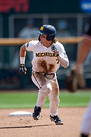 Michigan Wolverines outfielder Jesse Franklin (7) runs to third base during Game 1 of the NCAA College World Series against the Texas Tech Red Raiders on June 15, 2019 at TD Ameritrade Park in Omaha, Nebraska. Michigan defeated Texas Tech 5-3. (Andrew Woolley/Four Seam Images)