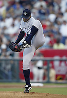 Orlando Hernandez of the New York Yankees pitches during a 2002 MLB season game against the Los Angeles Angels at Angel Stadium, in Anaheim, California. (Larry Goren/Four Seam Images)