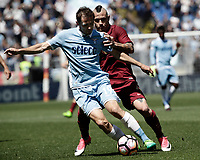 Calcio, Serie A: Roma, stadio Olimpico, 30 aprile 2017.<br /> Lazio's Senad Lulic (l) in action with AS Roma's Radja Nainggolan (r) during the Italian Serie A football match between AS Roma an Lazio at Rome's Olympic stadium, April 30 2017.<br /> UPDATE IMAGES PRESS/Isabella Bonotto