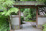 Tea Garden Gate and flagstone walkway, Portland Japanese Garden.  The Japanese Garden in Portland is a 5.5 acre respit.  Said to be one of the most authentic Japanese Garden's outside of Japan, the rolling terrain and water features symbolize both peace and strength.