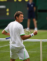 26-06-13, England, London,  AELTC, Wimbledon, Tennis, Wimbledon 2013, Day three, Sergly Stakhovsky (UKR) wins the third set end makes a fist to his coach<br /> <br /> <br /> <br /> Photo: Henk Koster