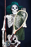 Skelton dressed to go fly fishing.  Classic fly rod and reel, wooden net.