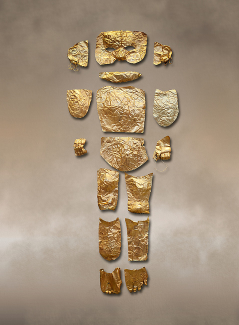 Body shaped Mycenaean gold cut outs from Grave III, 'Grave of a Women', Grave Circle A, Myenae, Greece. National Archaeological Museum Athens.<br /> <br /> Cat No 146. 16th century BC.<br /> <br /> A unique gold body covering and face of an infant child mad out of pieces of gold foll<br /> <br /> Shaft Grave III, the so-called 'Grave of the Women,' contained three female and two infant interments. The women were literally covered in gold jewelry and wore massive gold diadems, while the infants were overlaid with gold foil.