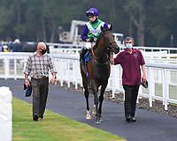 Winner of The Fovant Fillies' Handicap  Clever Candy (purple cap) ridden by Kieran Shoemark and trained by Michael Bell  is led into the Winners enclosure during Horse Racing at Salisbury Racecourse on 13th August 2020