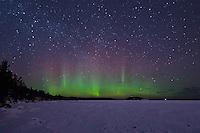 A view of the Northern Lights over a frozen Lake Superior shoreline. Marquette, MI