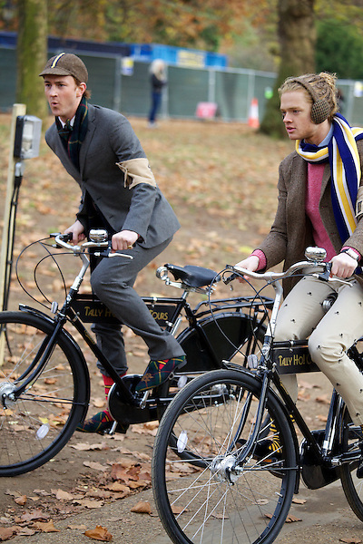 Francis Boulle and Fredrik Ferrier ride their bicycles on The Tweed Run