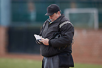 Home plate umpire Randy Vestal checks his lineup card during an NCAA baseball game between the Bryant Bulldogs and the High Point Panthers at Williard Stadium on February 21, 2021 in  Winston-Salem, North Carolina. The Panthers defeated the Bulldogs 3-2. (Brian Westerholt/Four Seam Images)