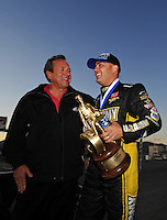 Nov. 2, 2008; Las Vegas, NV, USA: NHRA top fuel dragster driver Tony Schumacher (right) with his father Don Schumacher after winning the Las Vegas Nationals at The Strip in Las Vegas. Mandatory Credit: Mark J. Rebilas-