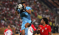 Costa Rica's Esteban Alvarado (1) captures a goal kick over the head of Egypt's Salah Soliman (2) during the FIFA Under 20 World Cup Round of 16 match at the Cairo International Stadium on October 06, 2009 in Cairo, Egypt.