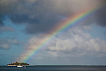 Rainbow over atoll in Maupiti, French Polynesia