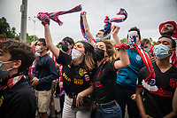 MADRID, SPAIN – MAY 23: Atletico Madrid fans celebrate after team has won the league at the Neptune Fountain on 23 May in Madrid, Spain. (Photo by Joan Amengual/VIEWpress )