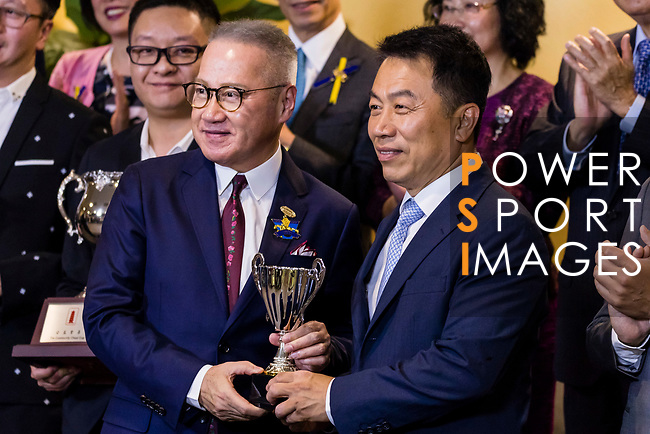 Trainer Ricky Yiu Poon-fai (R) poses for photo with trophy after winning the Community Chest Cup (Handicap) with his horse Keep Moving during Hong Kong Racing at Happy Valley Racecourse on September 12, 2018 in Hong Kong, Hong Kong. Photo by Yu Chun Christopher Wong / Power Sport Images