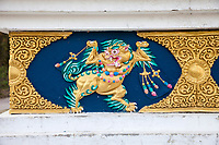 India, Dehradun.  Mythological Figure Decorating the Base of a Stupa on the Grounds of the Buddhist Temple of Dehradun and Mindrolling Monastery.