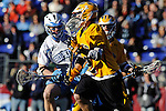 Face-Off Classic: Attackman Dave Brown #2 of the UMBC Retrievers attempts to make a move on a Hopkins defender during the UMBC v Johns Hopkins mens lacrosse game at M&T Bank Stadium on March 10, 2012 in Baltimore, Maryland. (Ryan Lasek/ Eclipse Sportswire)