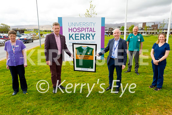 Tim Murphy (Chairman of the Kerry County GAA Committee) presenting a Kerry jersey to Fergal Grimes at the UHK as part of a national initiative to recognise Frontline Workers on Tuesday. L to r: Ann O'Shea, Tim Murphy (Kerry GAA), Fergal Grimes (UHK Manager), Martin Boyd and Karina Gilligan.