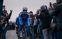 defending champion Philippe Gilbert (BEL/Quick Step floors) rolling to the pre-race team presentation, being 'cell-phone-snapped' all the way there<br /> <br /> 102nd Ronde van Vlaanderen 2018 (1.UWT)<br /> Antwerpen - Oudenaarde (BEL): 265km